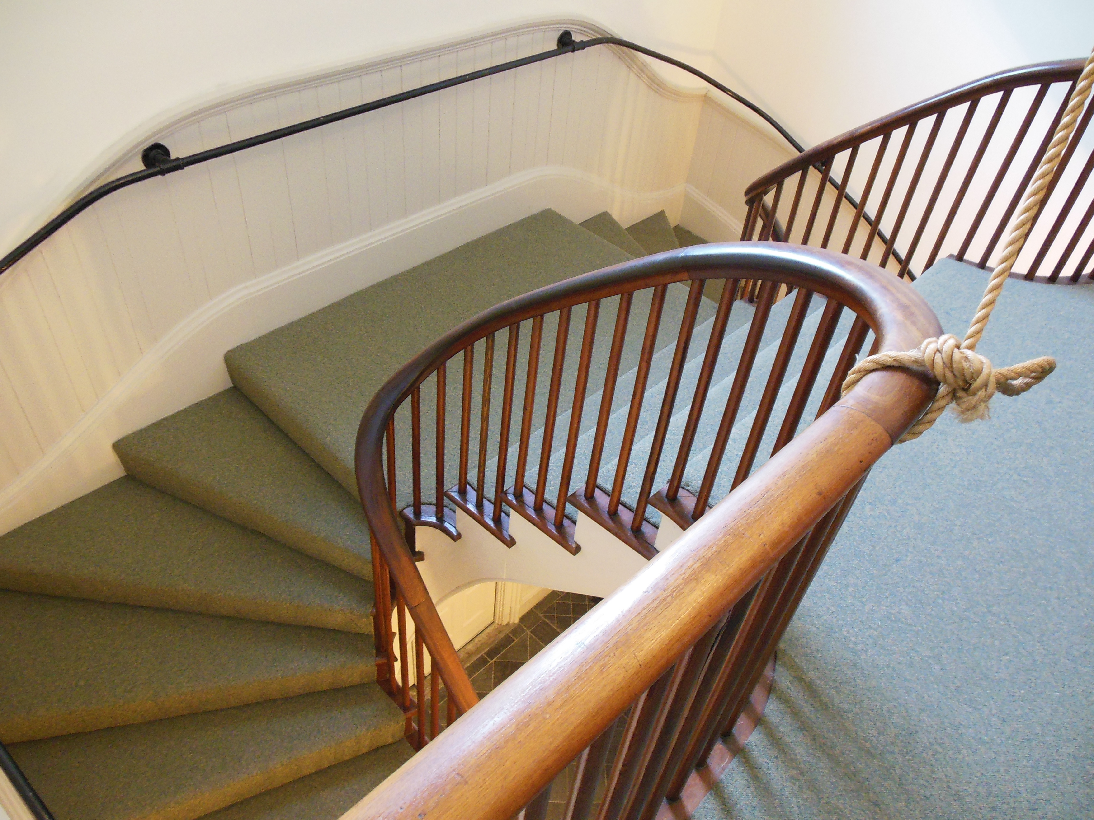 THE WINDING FRONT STAIRCASE TO THE UPSTAIRS COURTROOM